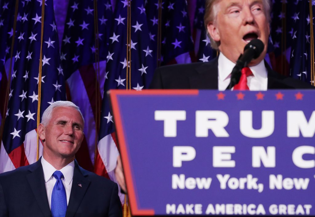 Republican president-elect Donald Trump delivers his acceptance speech as Vice president-elect Mike Pence looks on during his election night event at the New York Hilton Midtown