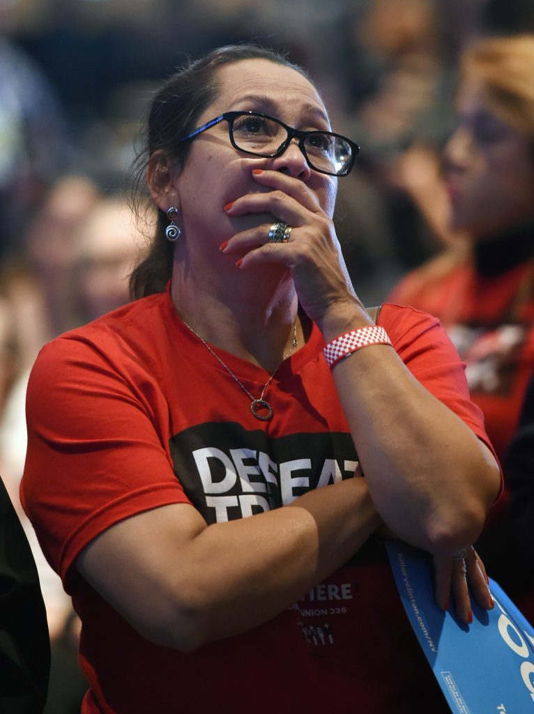 Hillary Clinton supporter Irayda Torrez reacts as she watches the presidential election swing in favour of Donald Trump at the Nevada Democratic Party's election results watch party
