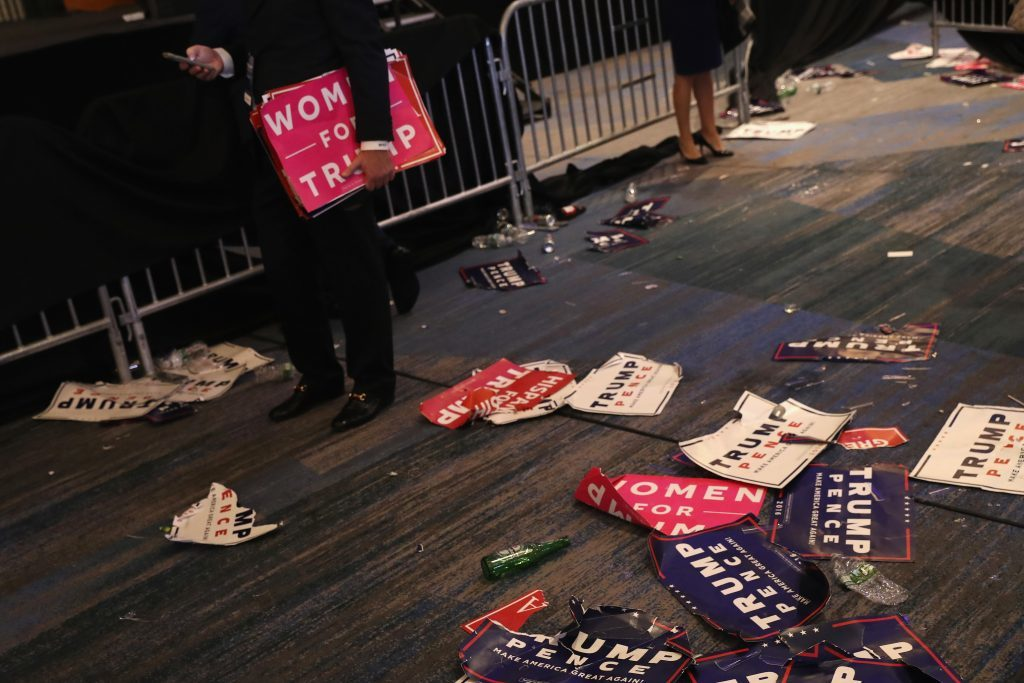 Campaign signs are seen on the floor after Republican president-elect Donald Trump delivered his acceptance speech during his election night event at the New York Hilton Midtown