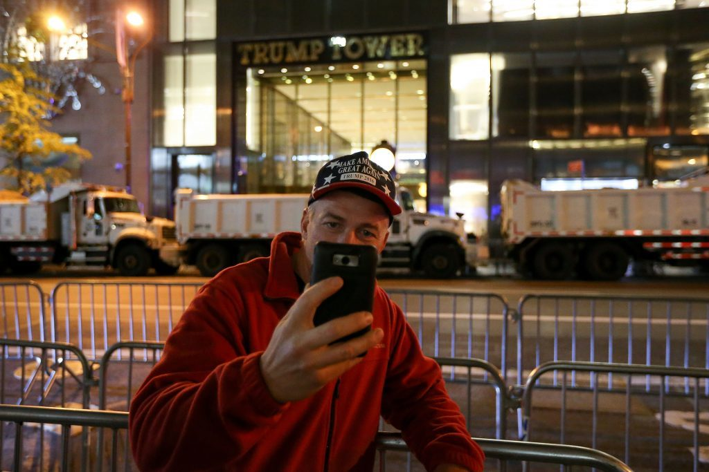 A Donald Trump supporter takes a selfie outside Trump Tower
