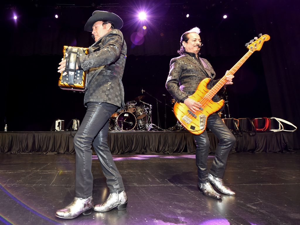 Recording artists Jorge Hernandez (L) and Hernan Hernandez of the band Los Tigres del Norte perform at the Nevada Democratic Party's election results watch party