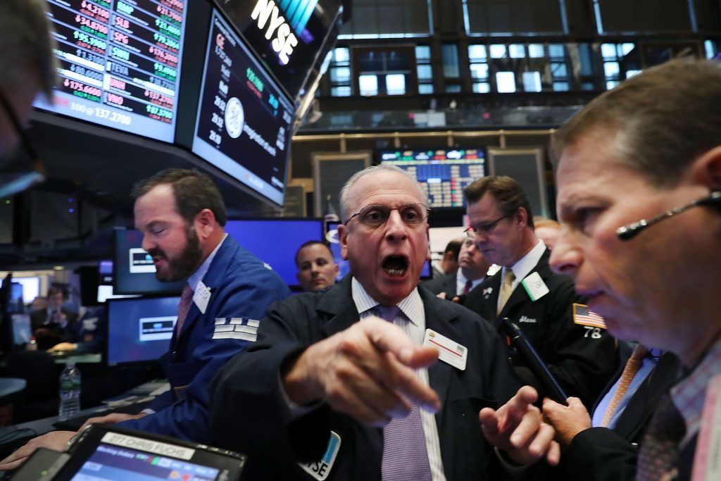 Traders work on the floor of the New York Stock Exchange (NYSE) the morning after Donald Trump won a major upset in the presidential election