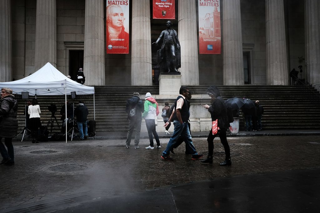 A statue of George Washington stands along wall Street the morning after Donald Trump won a major upset in the presidential election