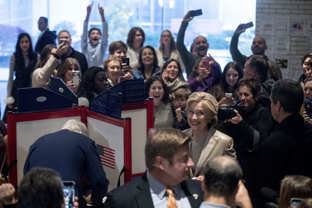 Democratic presidential candidate Hillary Clinton, accompanied by her husband Bill smiles as she votes at Douglas G. Grafflin School in Chappaqua, N.Y.
