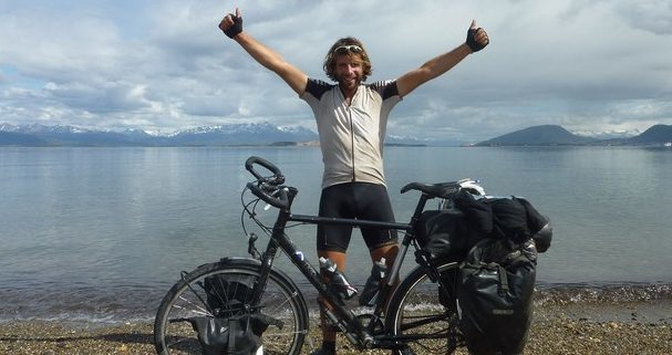 Mark Beaumont celebrates after finishing his Cycling the Americas adventure in Argentina