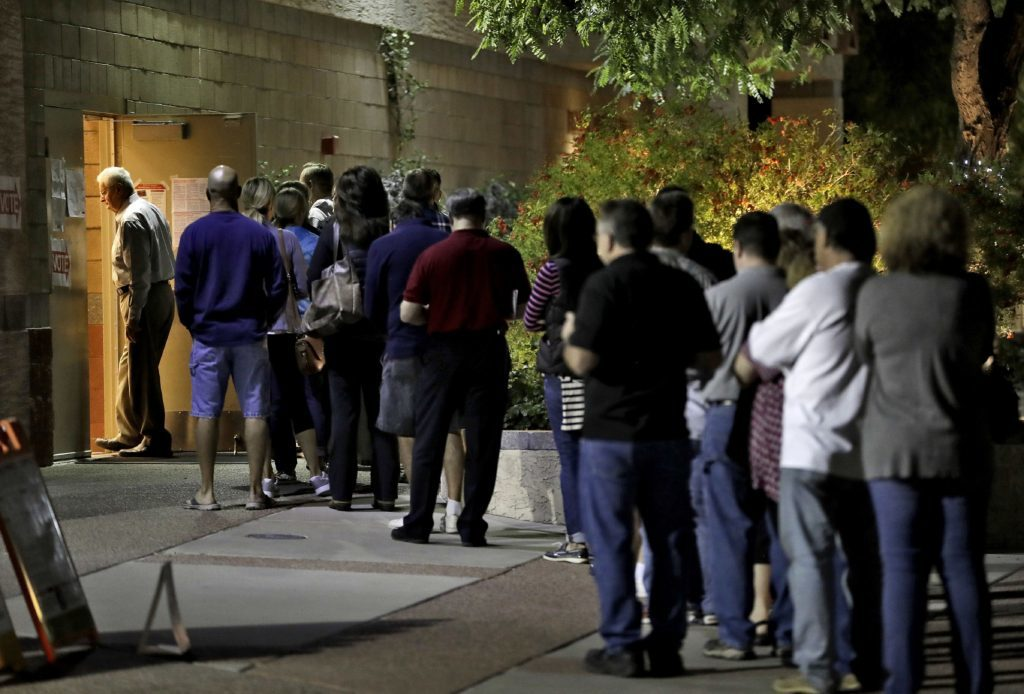 Voters wait in line to vote early in Phoenix.