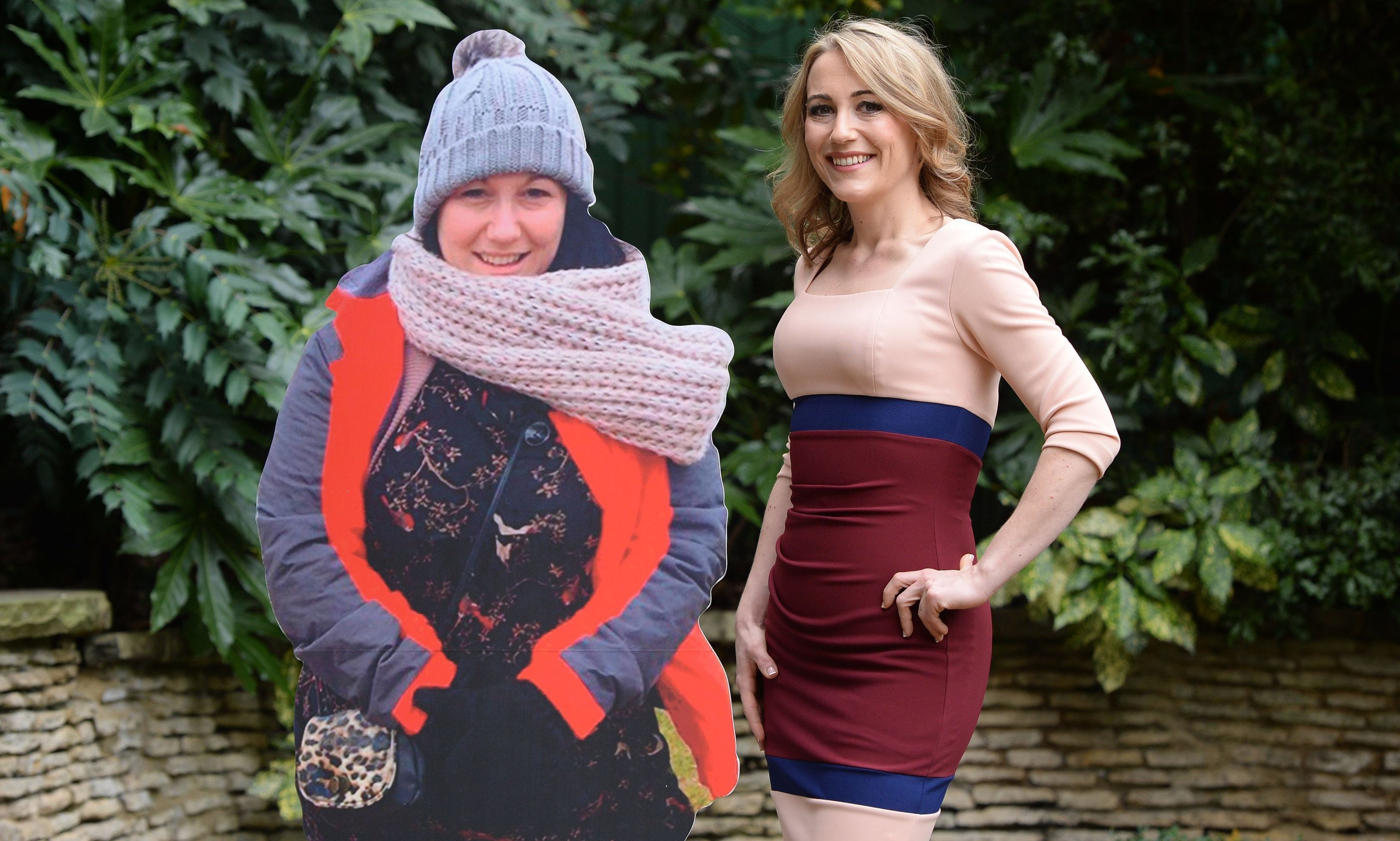 Hollie Barrett, 30, from Blunderston in Suffolk, poses with a cardboard cut-out of her former self.