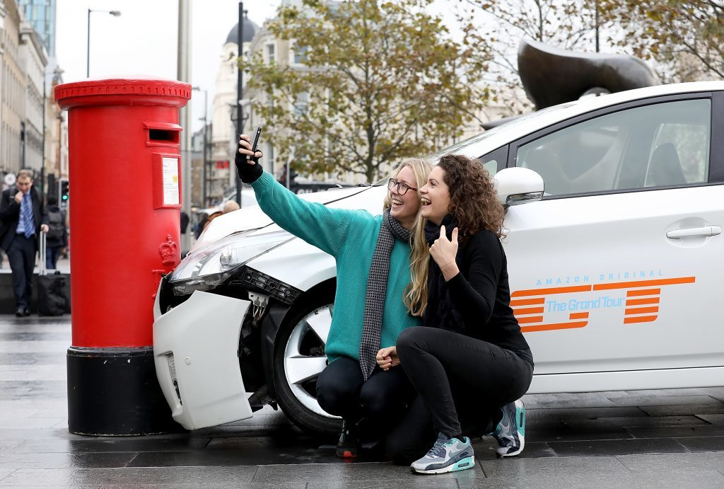 A car 'crashed' into a post box outside King's Cross Station in London, United Kingdom on November 15, 2016, ahead of the launch of 'The Grand Tour'.
