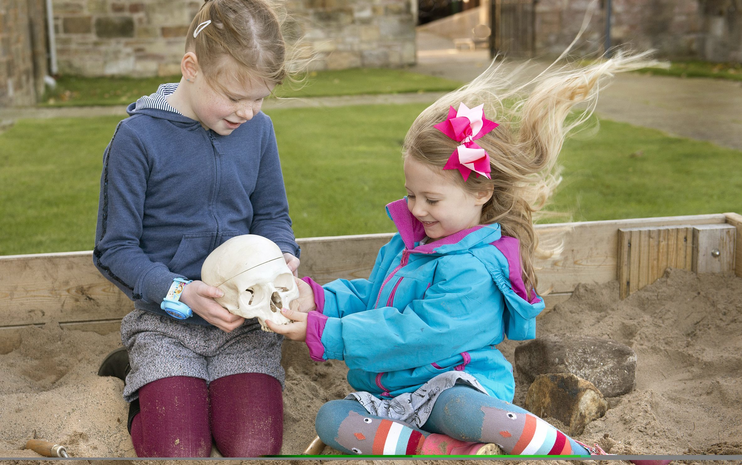 """Joanna, 7, and Rosalie, 4, dig for archaeological """"treasure"""" in MUSA's archaeological dig simulation to celebrate the museum's win as Best Visitor Experience 2016."""