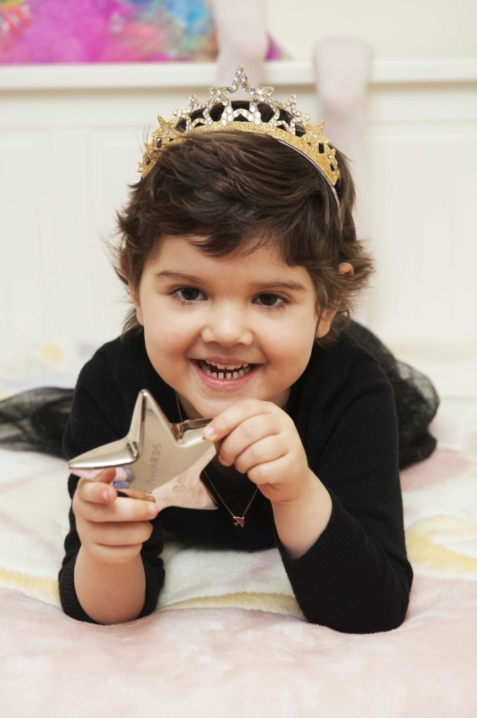 Lydia with her star award.