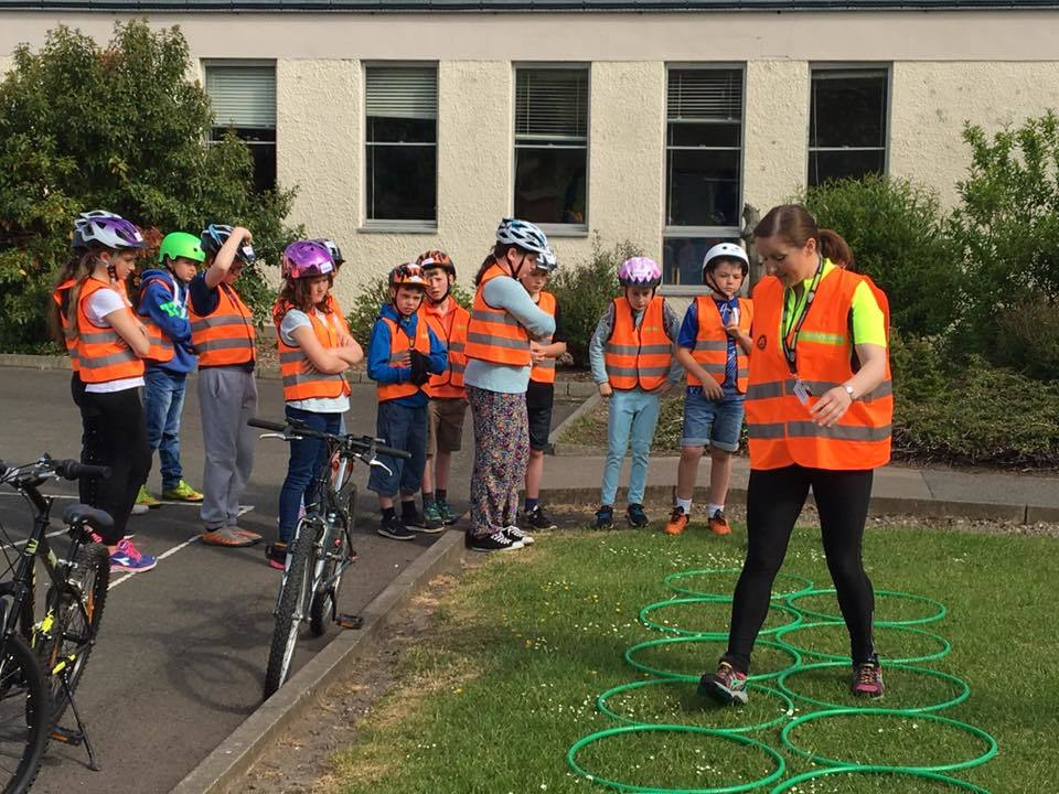 Marianne Berghuis working with Bikeability children and other volunteers in Fife