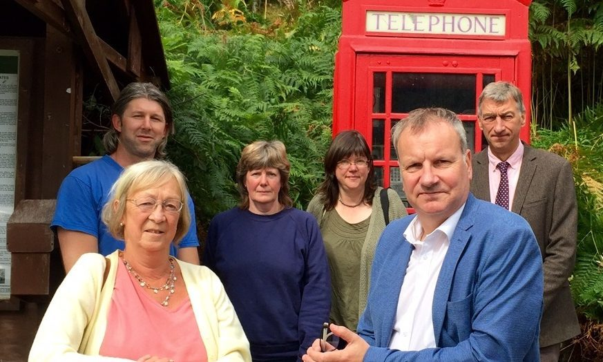 Joe Thompson, June Riddell, Wendy Kirk, Jeanie Grant, Pete and Mike Williamson, with Pete Wishart at Bridge of Balgie telephone box - one of the 84 in Perth and Kinross under threat.