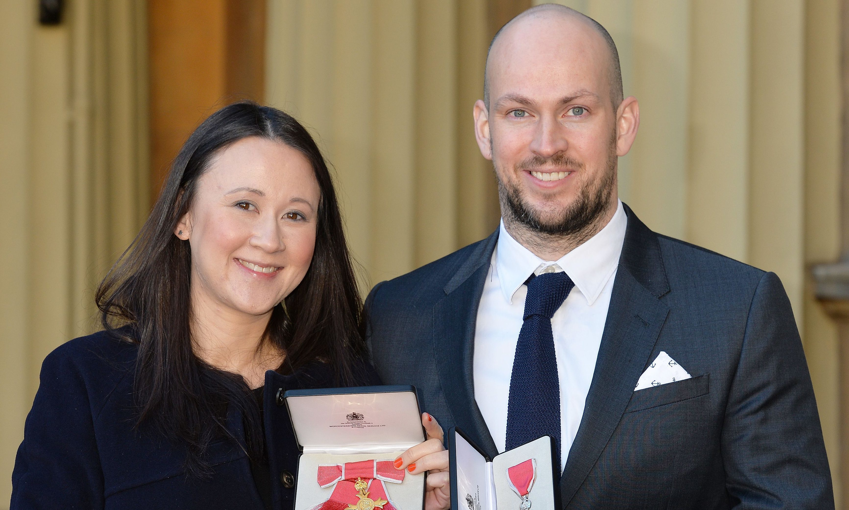 Johanna Basford with her OBE and husband James Watt with his MBE which they received from the Duke of Cambridge during an investiture ceremony at Buckingham Place.