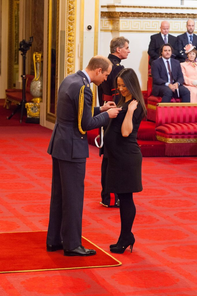 Johanna Basford is made an OBE (Officer of the Order of the British Empire) by the Duke of Cambridge.
