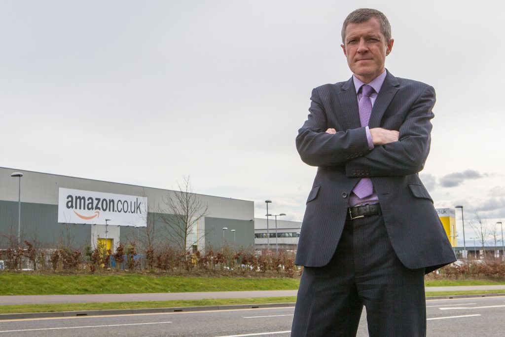 MSP Willie Rennie outside Amazon in Dunfermline.