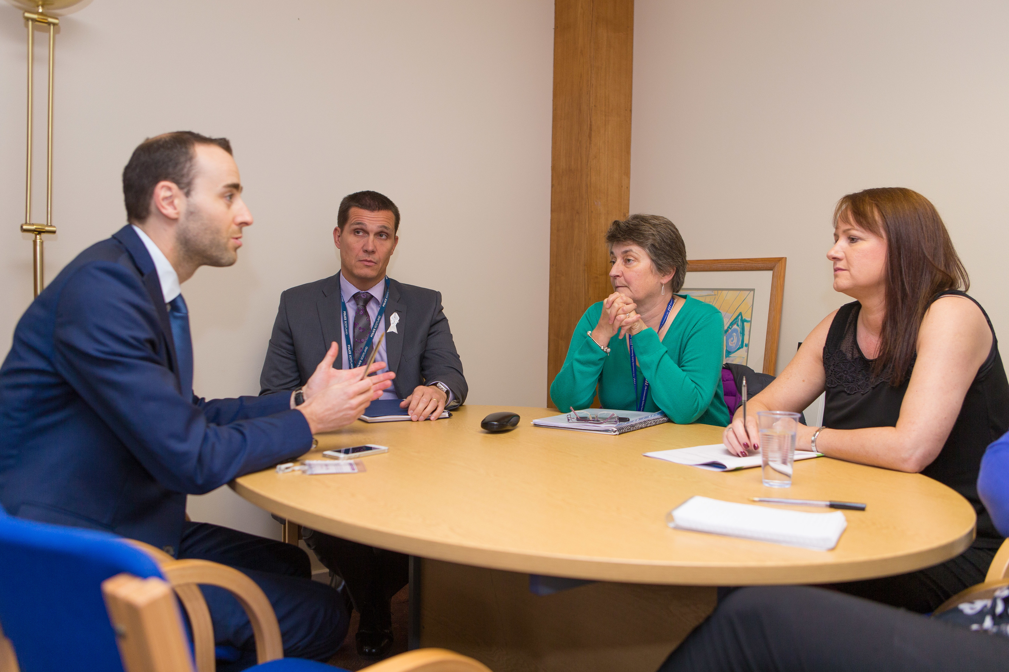 Reporter Jonathan Watson discusses domestic abuse handing in Fife with (from left) DI Jim Leeson, Sheila Noble (Fife Violence Against Women Partnership) and Womans Aid representative Lynda Noble