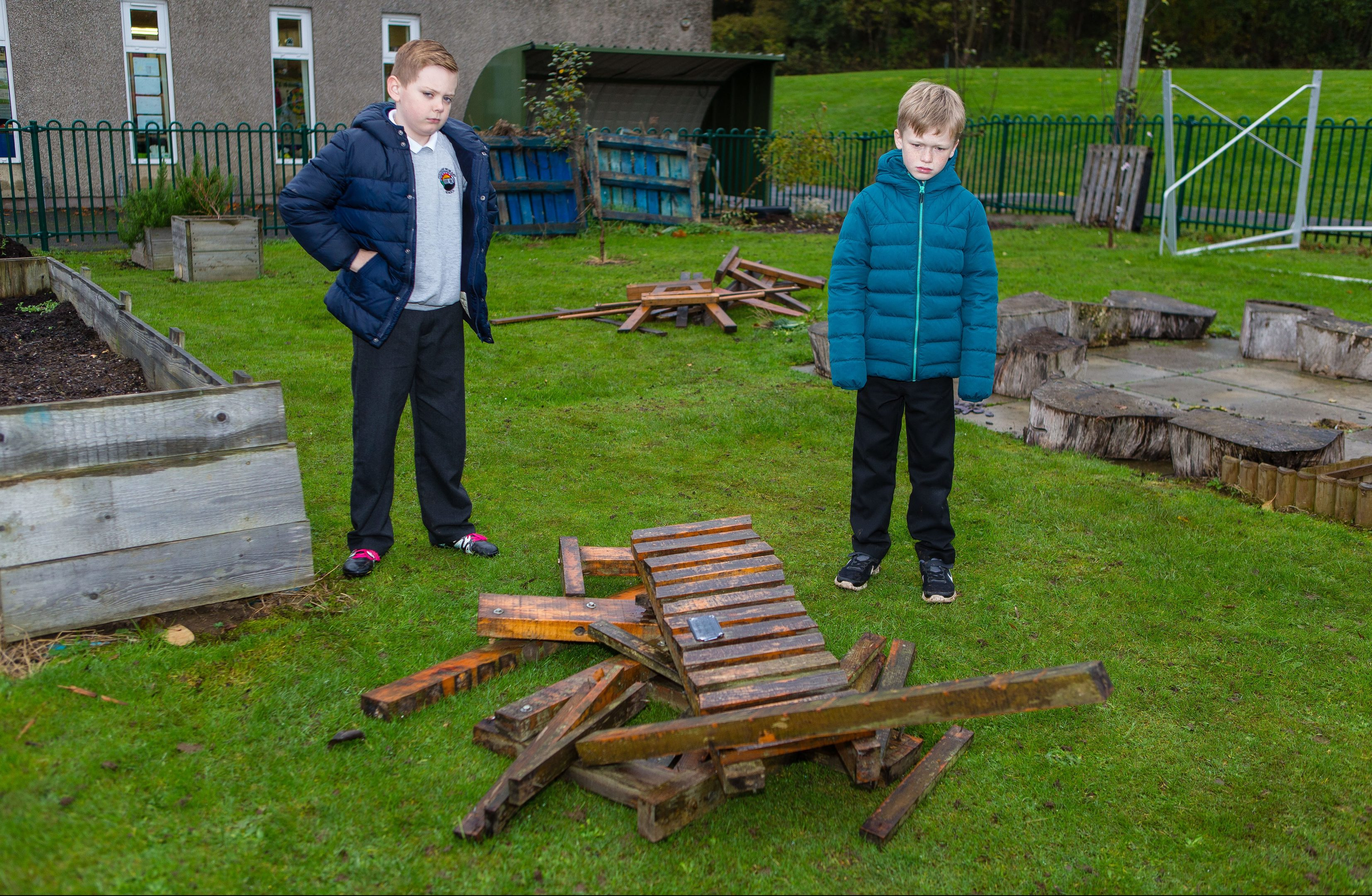 Pupils were devastated to find their communal garden destroyed by vandals earlier this month. Pictured are Sean Gilles (10) and Makenzie McLellan (9) in the gardens where the vandalism ruined all their hard work.