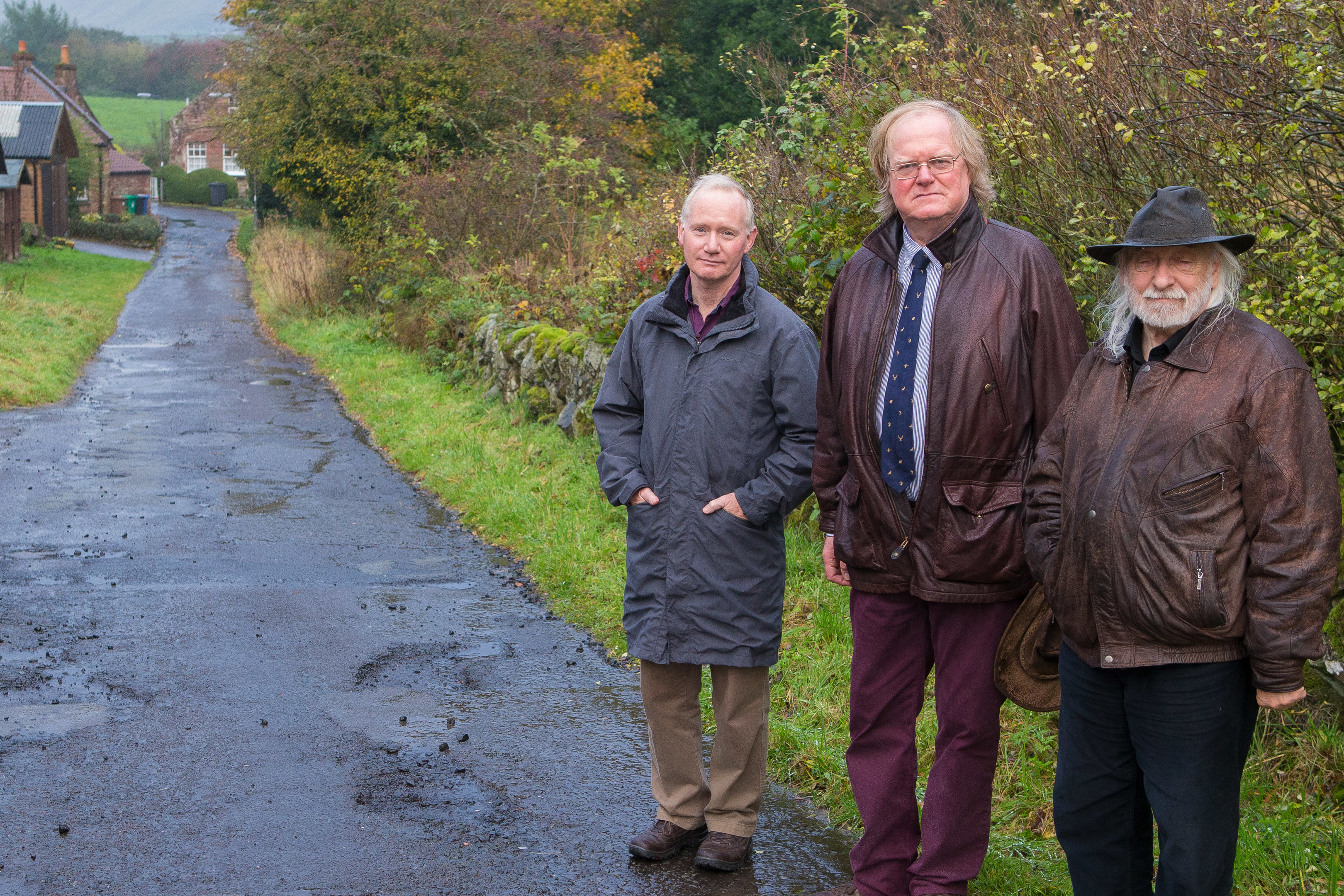 Councillor Andy Heer (centre) with concerned residents David Cowling and Andrew MacNaughton in Gateside