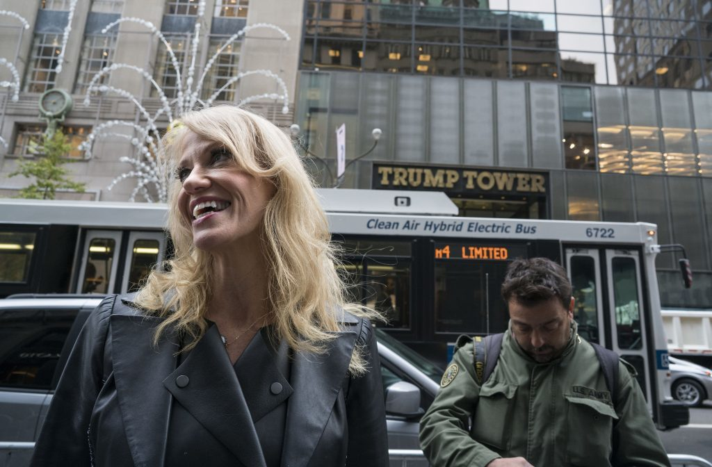 Kellyanne Conway, campaign manager for President-elect Donald Trump, pauses to speak to passersby across form Trump Tower in New York