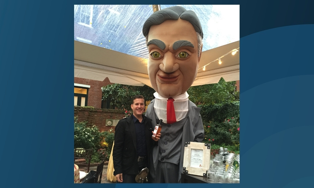 David Stirling with a caricature of Herbert Hoover at the Washington event.