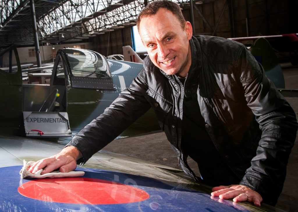 Iain Hutchison giving his Spitfire some TLC