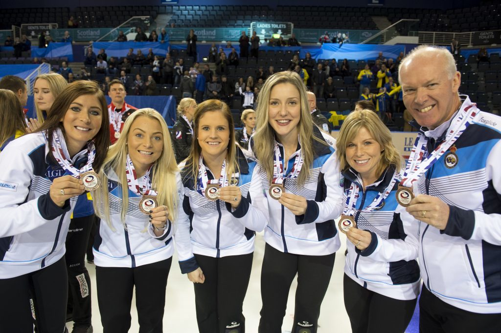 Eve and her team with their bronze medals.