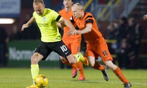 Dundee United's Willo Flood competes with Hibernian's Dylan McGeouch.