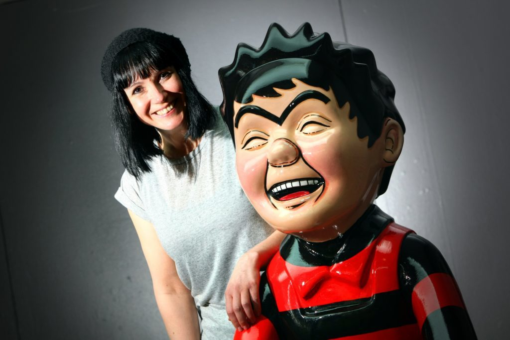Suzanne Scott, art coordinator for Oor Wullie's Bucket Trail with one of the sculptures.
