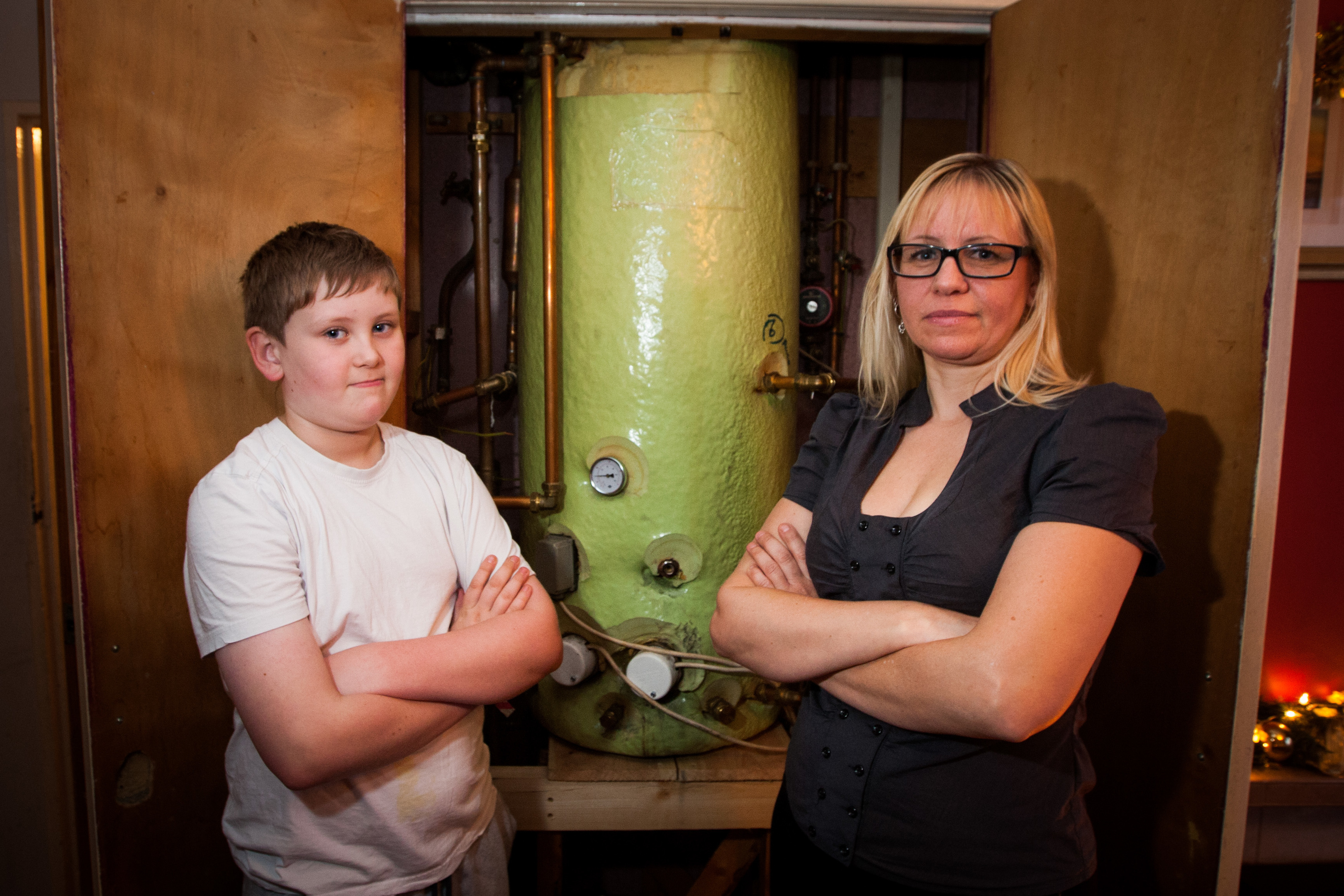 Nicola and Logan next to the faulty boiler