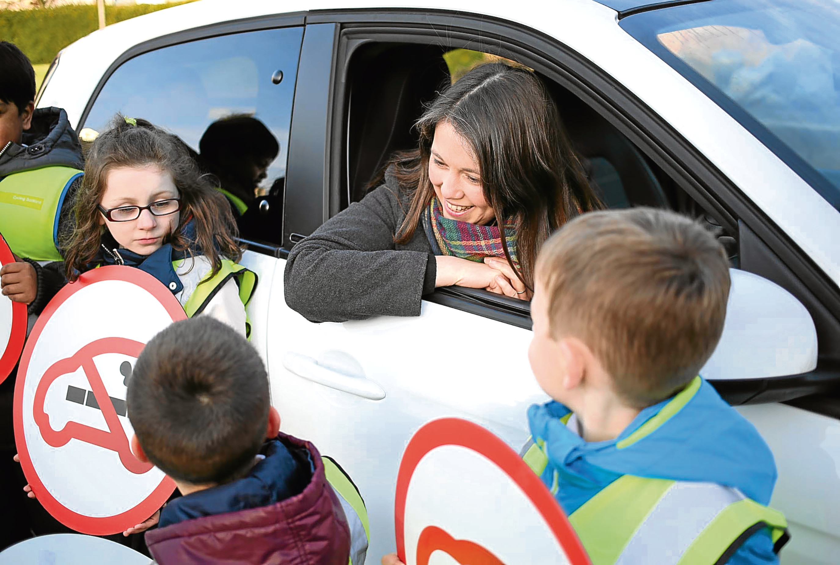 Aileen Campbell, Minister for Public Health and Sport, and some pupils from Edinburgh marked the day smoking in cars with children became illegal across Scotland. Picture: Allan Milligan.