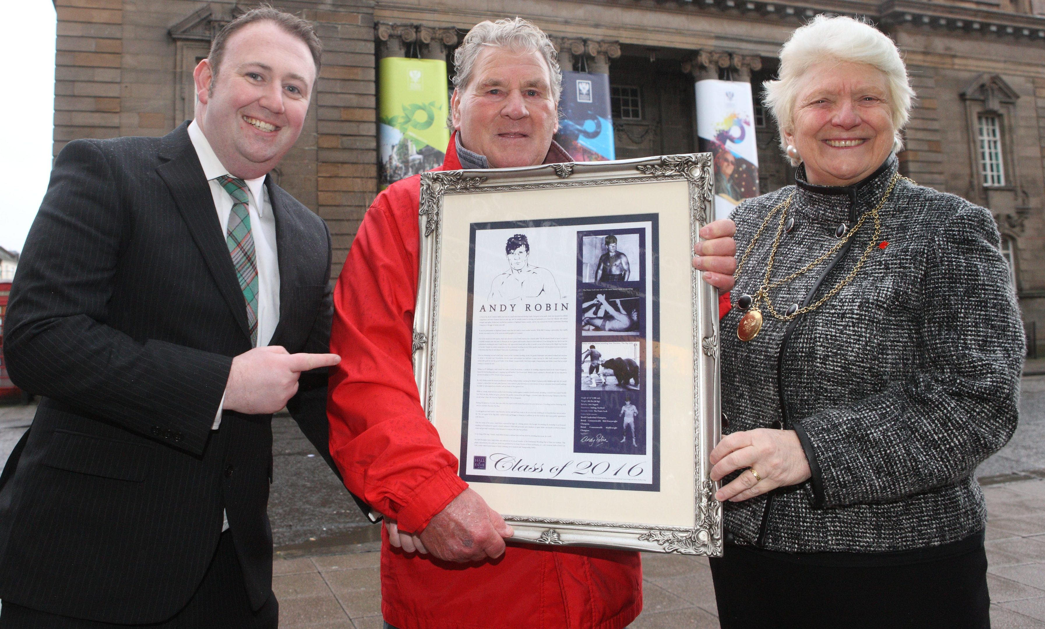 Andy Robin with (left) founder of the Professional Wrestling Hall of Fame Scotland Bradley Craig and (right) Perth Provost Liz Grant.