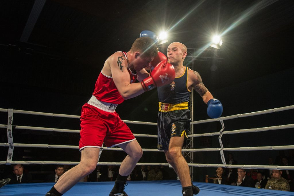 Cpl Ryan Bolam black shorts) fights Lance Corporal Andrew Foster.