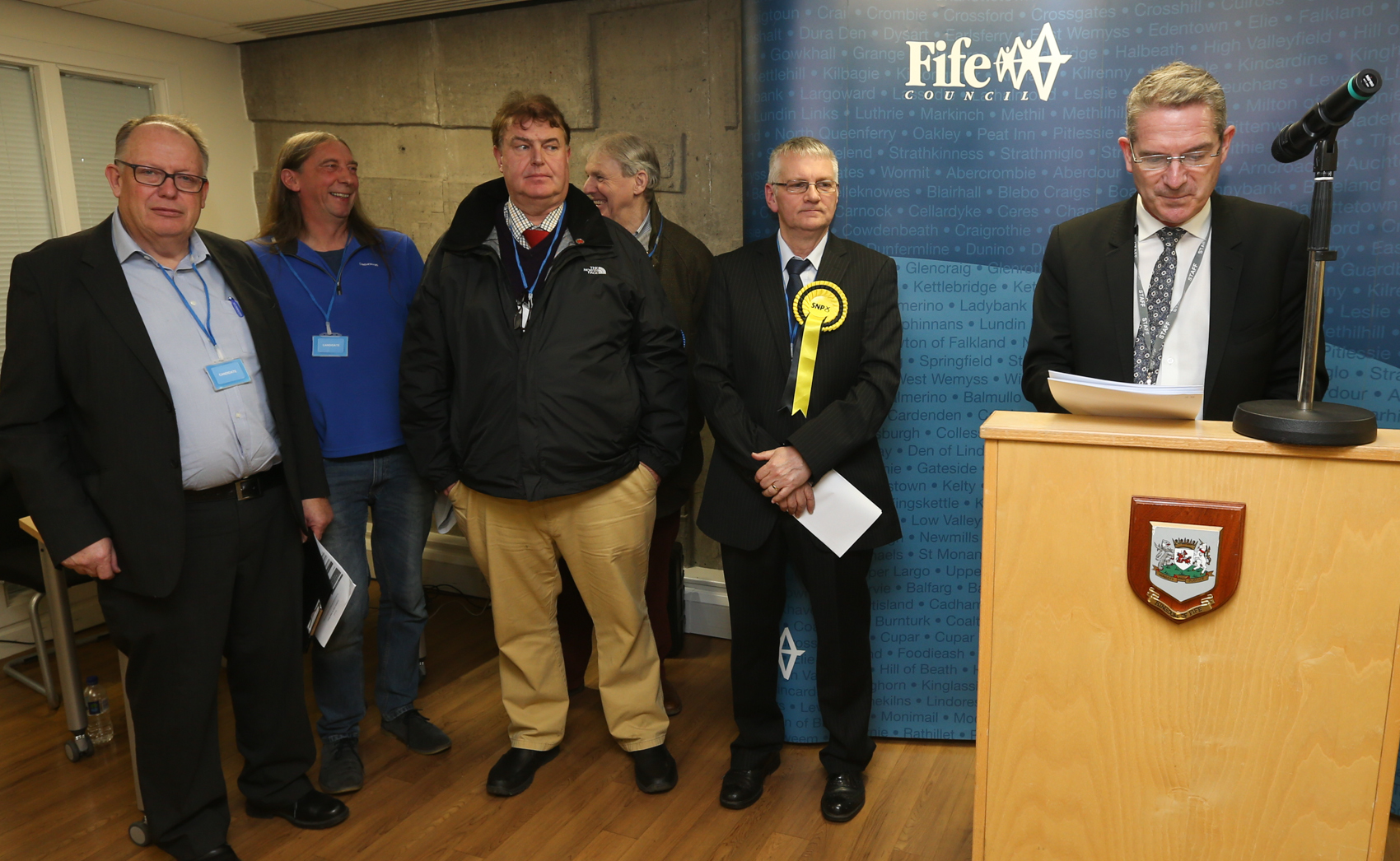 Returning officer Steve Grimmond (right) announces Alistair Suttie (second right) the winner