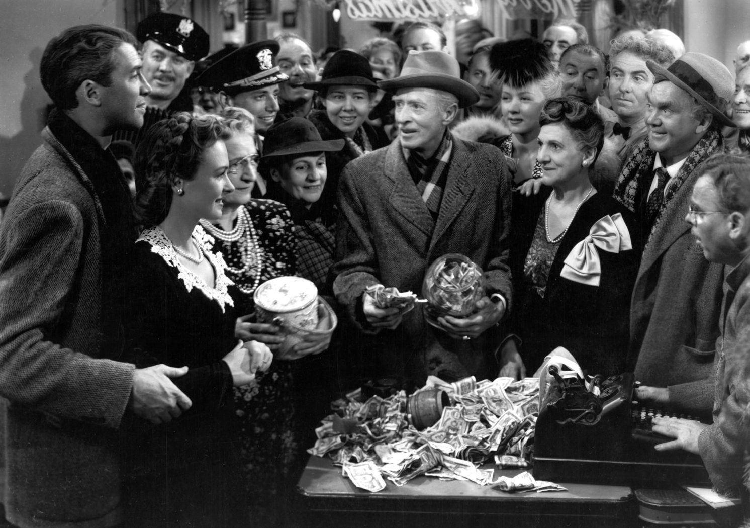 The scene in Its a Wonderful Life where the townspeople support George Bailey, played by James Stewart.