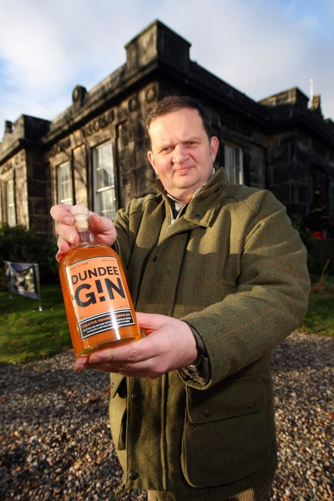 Peter Menzies with his marmalade-inspired Dundee Gin.