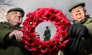 Cllr Ronnie Proctor and Jim Ritchie with a wreath at the memorial.