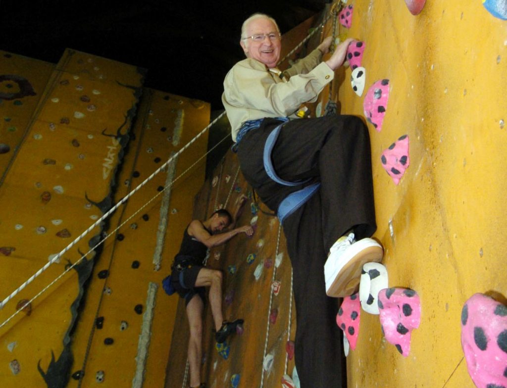 John Letford goes up in the world as he helps launch Dundee Mountain Film Festival at Avertical World in 2005.