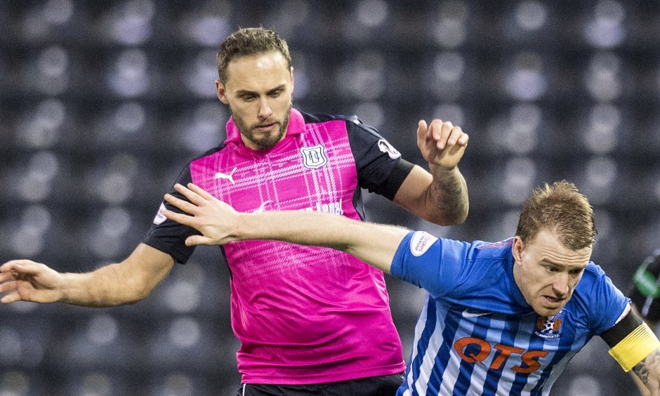 Tom Hateley, left, in action for Dundee at Rugby Park.