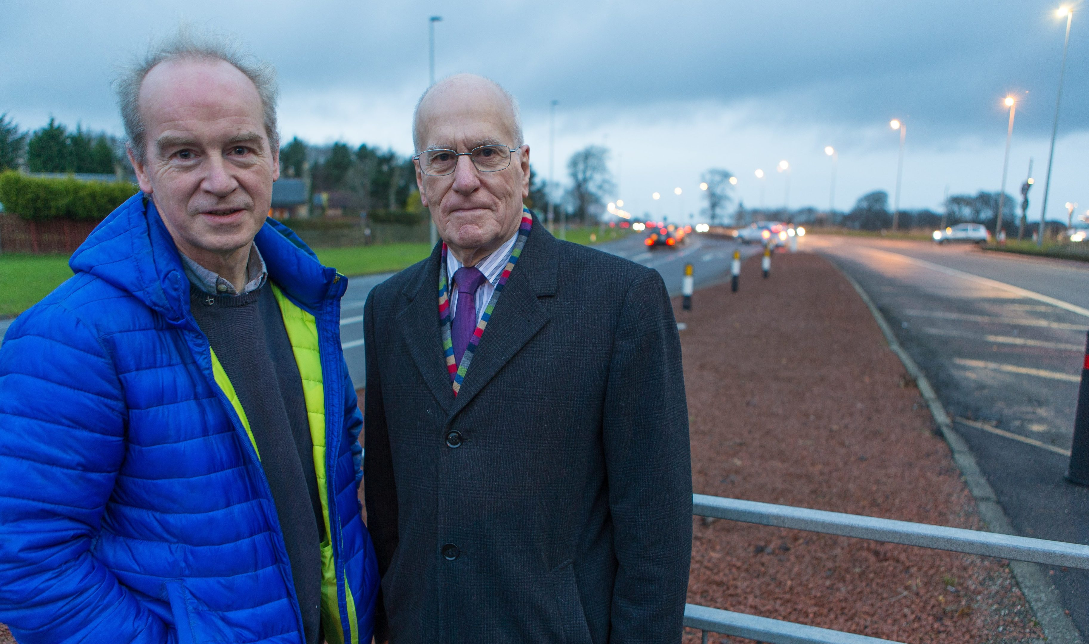 Councillor John Beare and Councillor Ross Vettraino beside the A92 at Balfarg, where a roundabout has been mooted.