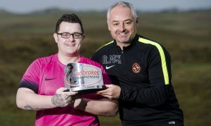 Dundee United manager Ray McKinnon presents the Goal of the Month trophy to Tommy McKay.