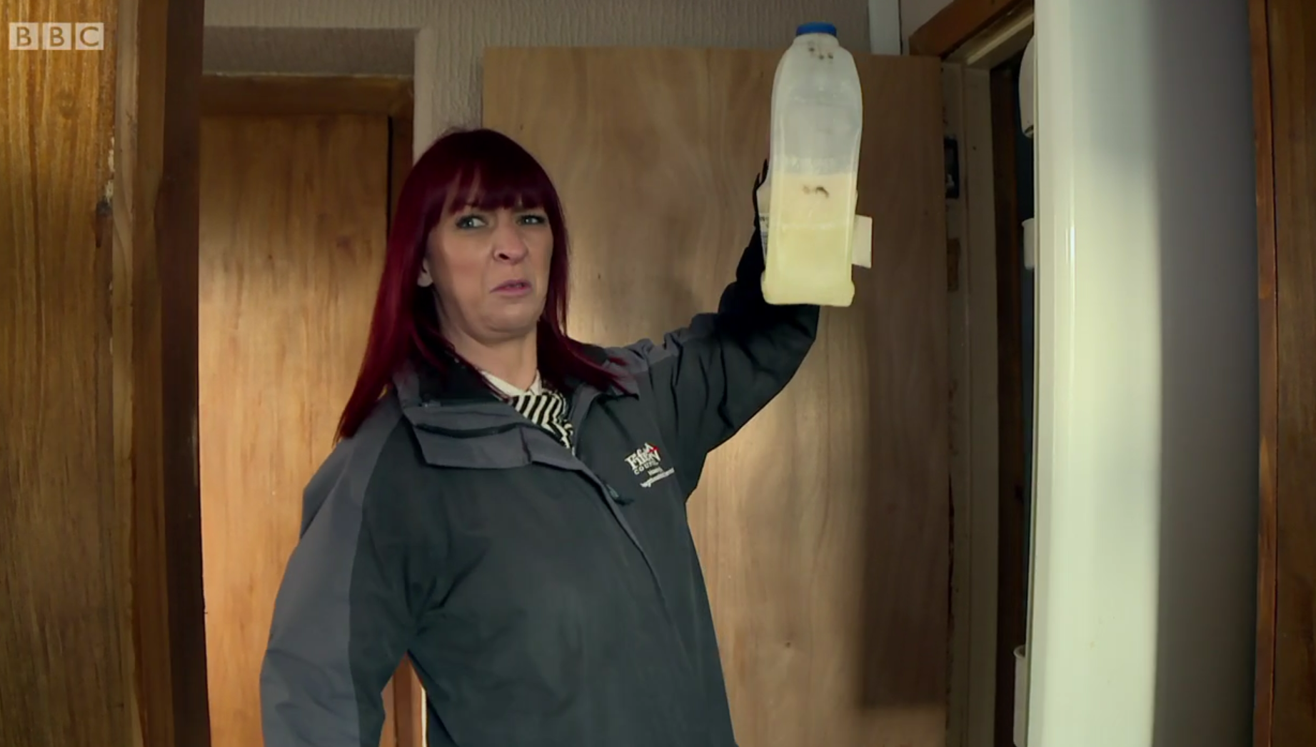 Housing officer Karen investigates an abandoned house in Collydean in a scene from The Council.
