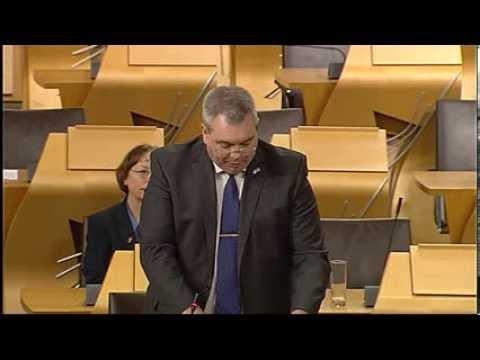 Alex Johnstone speaking at Holyrood.