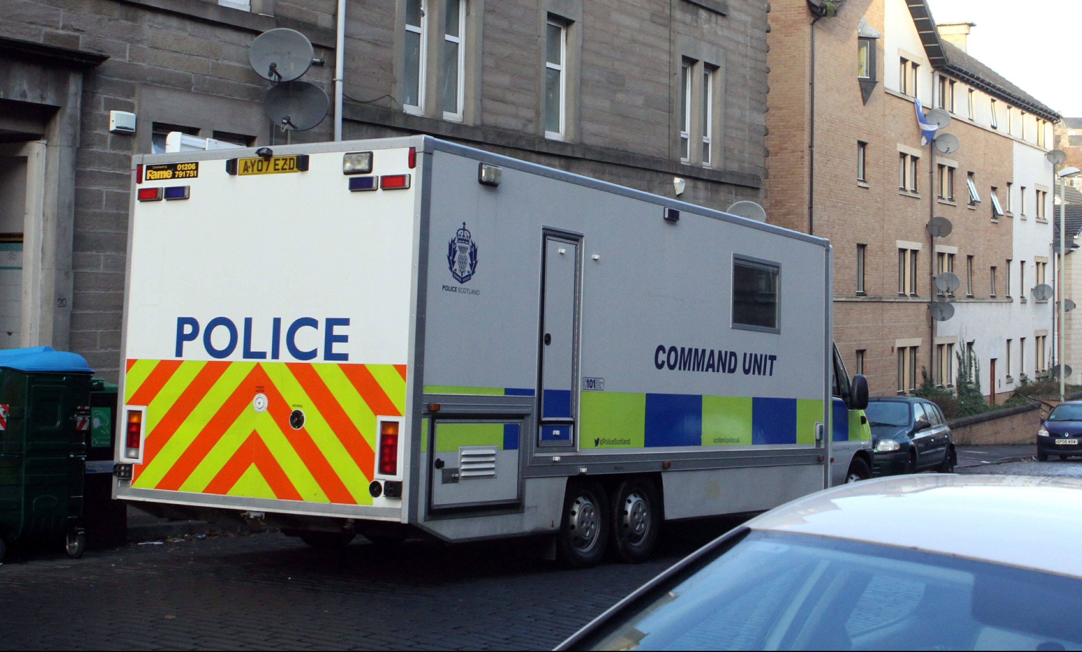 Police on Dundee's Rosefield Street after the discovery of Holly Alexander and Ronnie Kidd's bodies