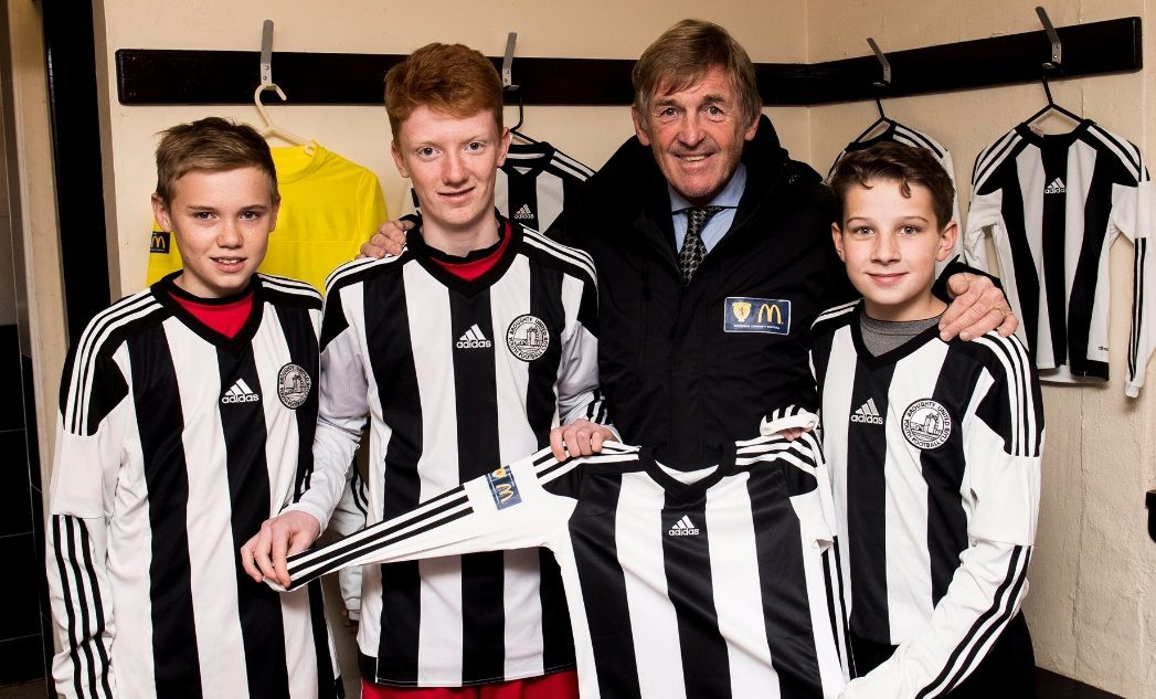 Kenny Dalglish with some of the Broughty United squad.