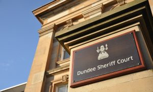 Pair to stand trial accused of robbing St Andrews pensioner
