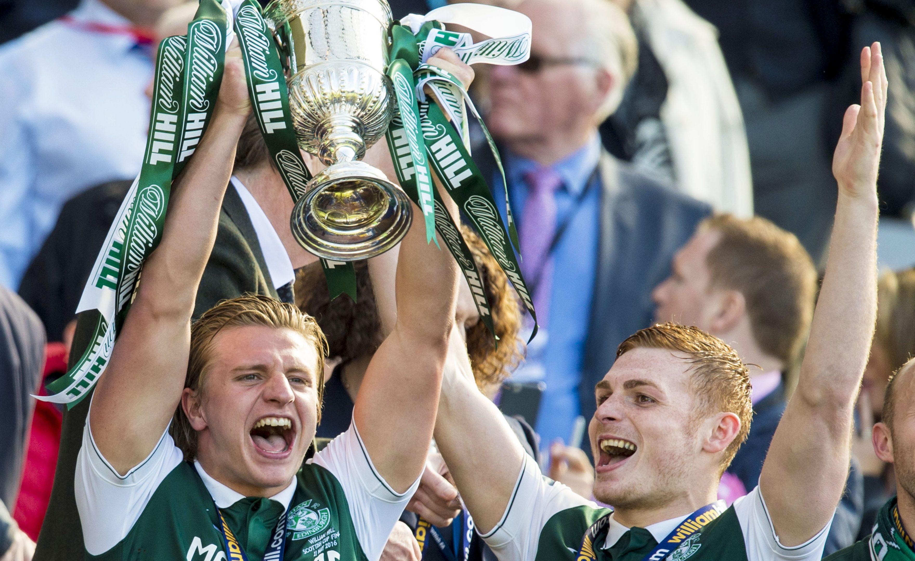 Hibs celebrate winning the cup.