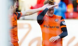 Dundee United's Simon Murray celebrates his opening goal.