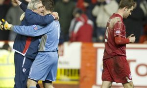 The nearest Steven MacLean (right) has come to a big cup upset was this defeat with Aberdeen to Raith Rovers.