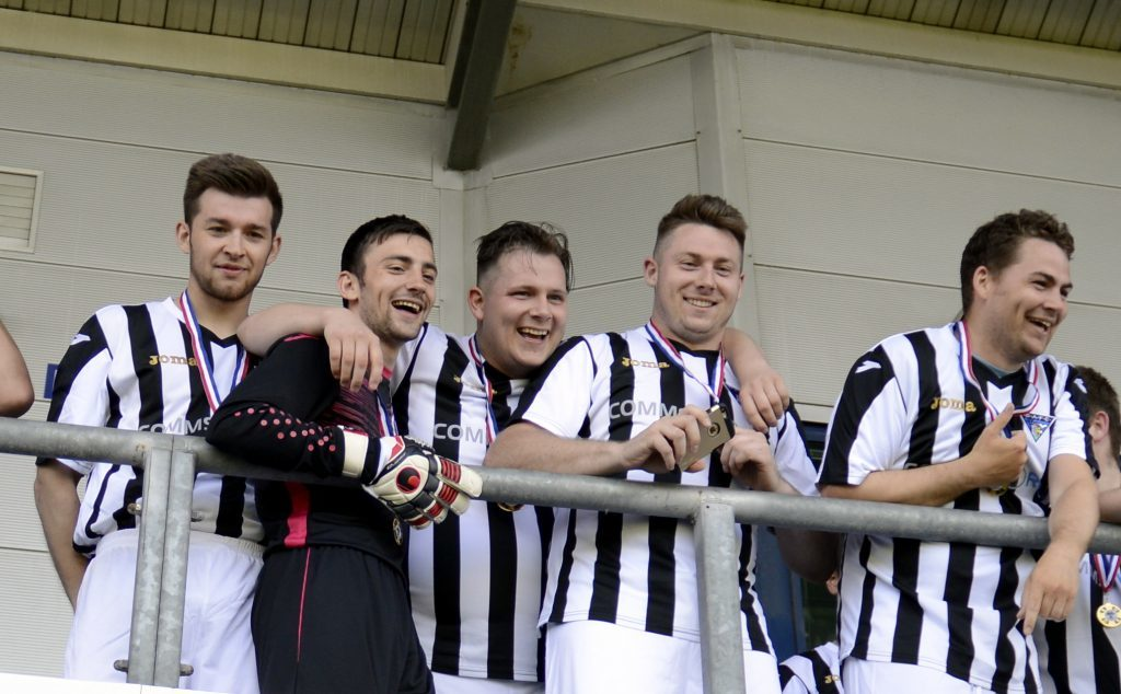 Dunfermline fans team against Falkirk, 2016. Iain Cook, pictured in the middle, celebrates with his teammates.