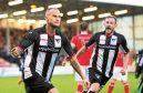 Dunfermline's Kallum Higginbotham celebrates his goal